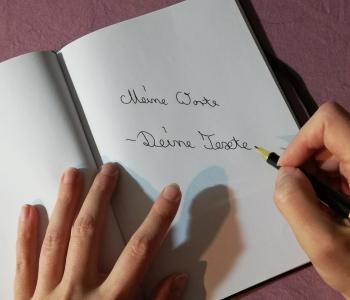 Hand mit Füller schreibt